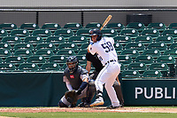Lakeland Flying Tigers Andrew Navigato (58) bats in front of catcher Carlos Narvaez (5) during a game against the Tampa Tarpons on May 16, 2021 at Joker Marchant Stadium in Lakeland, Florida.  (Mike Janes/Four Seam Images)