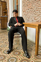 Argentina, Buenos Aires, Tango dancer, solo portrait, young man seated