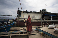 A monk looking for a boat to take him across the Ayeyarwaddy (Irrawaddy) River to his village on the other side.