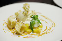 Fresh pineapple and waffle cubes served with mascarpone, vanilla ice cream and caramel sauce at L'Armoise restaurant, Antibes, France, 07 April 2012