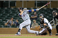 Surprise Saguaros third baseman Ryan Rua (9), of the Texas Rangers organization, at bat in front of catcher Dustin Garneau during an Arizona Fall League game against the Salt River Rafters on October 15, 2013 at Salt River Fields at Talking Stick in Scottsdale, Arizona.  Surprise defeated Salt River 9-2.  (Mike Janes/Four Seam Images)