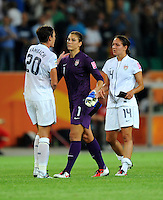 Abby Wambach (l), Hope Solo (C) and Stephanie Cox of team USA react during the FIFA Women's World Cup at the FIFA Stadium in Wolfsburg, Germany on July 6thd, 2011.