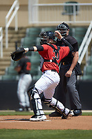 Kannapolis Intimidators catcher Michael Hickman (30) makes a throw to third base against the Delmarva Shorebirds at Kannapolis Intimidators Stadium on May 19, 2019 in Kannapolis, North Carolina. The Shorebirds defeated the Intimidators 9-3. (Brian Westerholt/Four Seam Images)