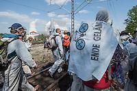 """Klimacamp """"Ende Gelaende"""" bei Proschim in der brandenburgischen Lausitz.<br /> Mehrere tausend Klimaaktivisten  aus Europa wollen zwischen dem 13. Mai und dem 16. Mai 2016 mit Aktionen den Braunkohletagebau blockieren um gegen die Nutzung fossiler Energie zu protestieren.<br /> Im Bild: Klimaaktivisten bei der Besetzung einer Bahnstrecke, die zur Versorgung des Kraftwerk Schwarze Pumpe (im Hintergrund) wichtig ist. Ihr Ziel ist, die Kohlezufuhr so lange zu unterbrechen, das dass Kraftwerk heruntergefahren werden muss.<br /> 14.5.2016, Schwarze Pumpe/Brandenburg<br /> Copyright: Christian-Ditsch.de<br /> [Inhaltsveraendernde Manipulation des Fotos nur nach ausdruecklicher Genehmigung des Fotografen. Vereinbarungen ueber Abtretung von Persoenlichkeitsrechten/Model Release der abgebildeten Person/Personen liegen nicht vor. NO MODEL RELEASE! Nur fuer Redaktionelle Zwecke. Don't publish without copyright Christian-Ditsch.de, Veroeffentlichung nur mit Fotografennennung, sowie gegen Honorar, MwSt. und Beleg. Konto: I N G - D i B a, IBAN DE58500105175400192269, BIC INGDDEFFXXX, Kontakt: post@christian-ditsch.de<br /> Bei der Bearbeitung der Dateiinformationen darf die Urheberkennzeichnung in den EXIF- und  IPTC-Daten nicht entfernt werden, diese sind in digitalen Medien nach §95c UrhG rechtlich geschuetzt. Der Urhebervermerk wird gemaess §13 UrhG verlangt.]"""