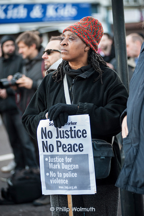 No Justice, No Peace vigil outside Tottenham Police Station in support of the family of Mark Duggan, whose killing by armed police sparked the 2011 riots, and in memory of others who have died during arrest or in poice custody.