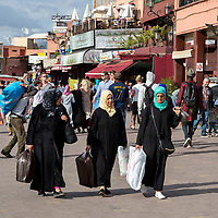 Marrakesh, Morocco.  Moroccan Women Going Home after Shopping.