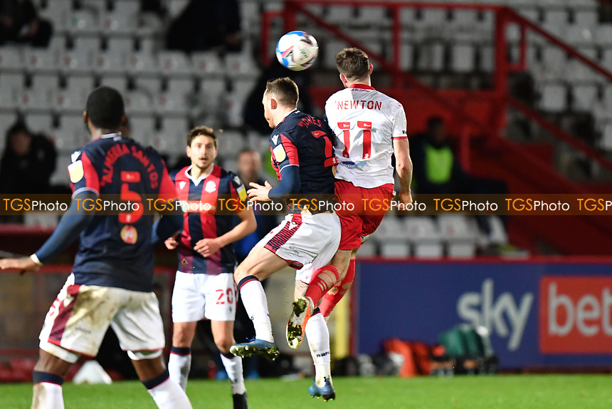 Danny Newton of Stevenage FC jumps with Nathan Delfouneso of Bolton Wanderers F.C. during Stevenage vs Bolton Wanderers, Sky Bet EFL League 2 Football at the Lamex Stadium on 21st November 2020