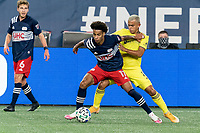 FOXBOROUGH, MA - OCTOBER 3: Tajon Buchanan #17 of New England Revolution dribbles as Randall Leal #8 of Nashville SC pressures during a game between Nashville SC and New England Revolution at Gillette Stadium on October 3, 2020 in Foxborough, Massachusetts.