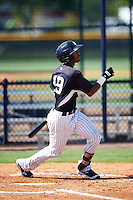 GCL Yankees East shortstop Yonauris Rodriguez (19) at bat during a game against the GCL Yankees West on August 3, 2016 at the Yankees Complex in Tampa, Florida.  GCL Yankees East defeated GCL Yankees West 12-2.  (Mike Janes/Four Seam Images)