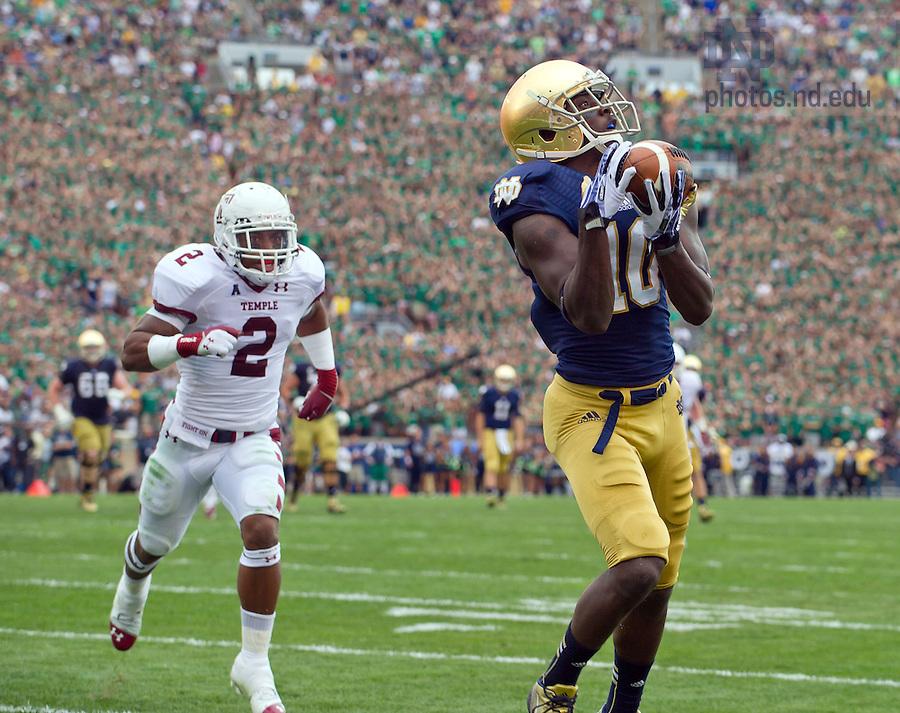 Aug. 31, 2013; DaVaris Daniels catches a pass for a touchdown against Temple.<br /> <br /> Photo by Matt Cashore