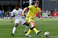 George Ott of the Wellington Phoenix competes for the ball with Kelvin Kalua of Eastern Suburbs during the ISPS Handa Men's Premiership - Wellington Phoenix v Eastern Suburbs at Fraser Park, Wellington on Saturday 28 November 2020.<br /> Copyright photo: Masanori Udagawa /  www.photosport.nz