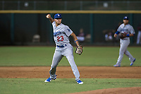 AZL Dodgers third baseman Leonel Valera (23) throws to first base during an Arizona League game against the AZL Indians 2 at Goodyear Ballpark on July 12, 2018 in Goodyear, Arizona. The AZL Indians 2 defeated the AZL Dodgers 2-1. (Zachary Lucy/Four Seam Images)