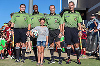 Ball girl Drew and game officials before NCAA soccer game, Sunday, October 26, 2014 in College Station, Tex. South Carolina draw 2-2 against Texas A&M in double overtime. (Mo Khursheed/TFV Media via AP Images)