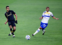 LOS ANGELES, CA - SEPTEMBER 02: Eddie Segura #4 of the LAFC passes off the ball during a game between San Jose Earthquakes and Los Angeles FC at Banc of California stadium on September 02, 2020 in Los Angeles, California.