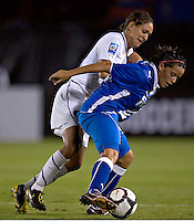 Stephanie Cox battles for the ball at the 2010 CONCACAF Women's World Cup Qualifying tournament held at Estadio Quintana Roo in Cancun, Mexico.