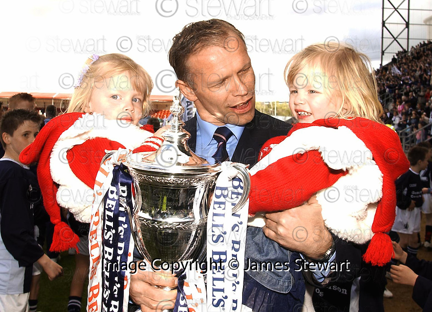 07/05/2005         Copyright Pic : James Stewart.File Name : jspa09_falkirk_v_qots.JOHN HUGHES WITH THE TROPHY AND HIS DAUGHTERS JESSICA AND VICTORIA.Payments to :.James Stewart Photo Agency 19 Carronlea Drive, Falkirk. FK2 8DN      Vat Reg No. 607 6932 25.Office     : +44 (0)1324 570906     .Mobile   : +44 (0)7721 416997.Fax         : +44 (0)1324 570906.E-mail  :  jim@jspa.co.uk.If you require further information then contact Jim Stewart on any of the numbers above.........A
