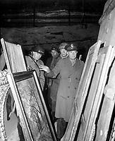 General Dwight D. Eisenhower, Supreme Allied Commander, accompanied by Gen. Omar N. Bradley, and Lt. Gen. George S. Patton, Jr., inspects art treasures stolen by Germans and hildden in salt mine in Germany.  April 12, 1945.  Lt. Moore.  (Army)<br /> NARA FILE #:  111-SC-204516<br /> WAR & CONFLICT BOOK #:  1099