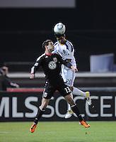 Los Angeles Galaxy defender A.J. DeLaGarza (20) heads the ball against DC United midfielder Chris Pontius (13).  DC United tied Los Angeles Galaxy 1-1, at RFK Stadium, Saturday April 9, 2011.