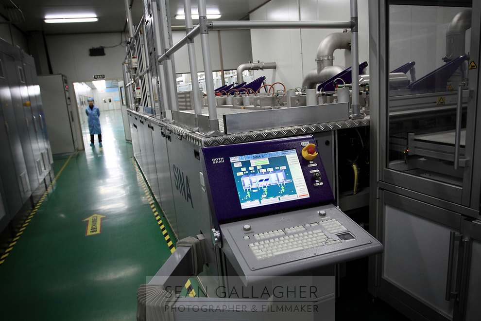CHINA. Hebei.  Inside a factory producing solar panels in Baoding City near Beijing, the world's first 'carbon positive' town. The town's main industires focus on producing wind and solar technologies. 2009