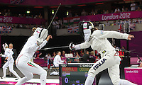 12 AUG 2012 - LONDON, GBR - Sabrina Crognale (ITA) (right) of Italy makes contact on Adrienn Toth (HUN) of Hungary  during their women's London 2012 Olympic Games Modern Pentathlon fencing at The Copper Box in the Olympic Park, in Stratford, London, Great Britain (PHOTO (C) 2012 NIGEL FARROW)