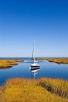 Sailboat anchored in a salt marsh leading into Cape Cod Bay, Wharf Lane, Yarmouthport, Cape Cod, MA, Massachusetts