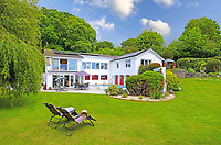 BNPS.co.uk (01202) 558833. <br /> Pic: LillicrapChilcott/BNPS<br /> <br /> Pictured: Gardens.<br /> <br /> This impressive waterfront home with breath-taking views is the perfect property for a wannabe sailor - on the market for £2.5m.<br /> <br /> Huefield sits in an elevated position looking over the rooftops of neighbouring properties onto the beautiful Helford River in Cornwall - ideal for watching boats coming and going.<br /> <br /> The Helford Passage area is so sought after houses rarely come up for sale and this one, on the market with Lillicrap Chilcott, is the only property available there at the moment.<br /> <br /> The five-bedroom home is south facing and has a swimming pool and beautiful gardens for enjoying the view, as well as access to a gate with a right of way down to the water.