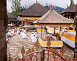 Worshippers participate in a ceremony at the Hindu temple of Ulun Danu at Candikuning, on Bali, Indonesia.  Located in the high hills of the Bedugul, about 30 miles north of Bali's capital city of Denpasar, the temple is built on the shores of the crater Lake Bratan (formed from the sunken crater of a long-dormant volcano).  Much of the inner precincts of the temple is closed to the (non-Hindu) public.