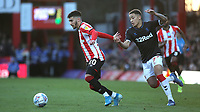 Marcus Tavernier of Middlesbrough pulls the arm of Brentford's Said Benrahma and earns himself a yellow card during Brentford vs Middlesbrough, Sky Bet EFL Championship Football at Griffin Park on 8th February 2020