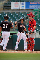 Jupiter Hammerheads center fielder Cameron Baranek (8) celebrates with catcher Michael Hernandez (27) in front of catcher Brian O'Keefe (32) after Hernandez hit a home run in the bottom of the second inning during a game against the Palm Beach Cardinals on August 5, 2018 at Roger Dean Chevrolet Stadium in Jupiter, Florida.  Jupiter defeated Palm Beach 3-0.  (Mike Janes/Four Seam Images)