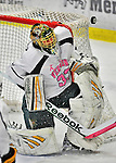 28 January 2012: University of Vermont Catamount starting goaltender Alex Vazzano, a Sophomore from Trumbull, CT, makes a second period shoulder pad save against the visiting Northeastern University Huskies at Gutterson Fieldhouse in Burlington, Vermont. The Catamounts, dressed in their Breast Cancer Awareness jerseys, fell to the Huskies 4-2 in the second game of their 2-game Hockey East weekend series. Mandatory Credit: Ed Wolfstein Photo