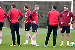 Cardiff - UK - 19th March 2013 : Simon Church (middle) taker a breather during a Wales football squad training session at the Vale Hotel near Cardiff ahead of their game with Scotland at the weekend.