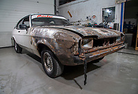 BNPS.co.uk (01202) 558833. <br /> Pic: MattRichardson/Classic Ford/BNPS<br /> <br /> Pictured: The motor before the restoration started. <br /> <br /> The legendary Ford Capri that starred in '80s TV show Minder has been restored to its former glory after a devastating fire wrecked the car.<br /> <br /> The 1977 white motor which appeared on the opening titles of the comedy-drama caught ablaze while it was returning from an MoT test last year.<br /> <br /> It is thought an electrical fault in the engine bay caused the fire. <br /> <br /> Now a mechanic who specialises in classic car restorations has unveiled the famous Ford after fixing it up over the past six months.