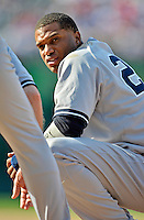16 June 2012: New York Yankees infielder Robinson Cano squats at first during a pitching change by the Washington Nationals at Nationals Park in Washington, DC. The Yankees defeated the Nationals in 14 innings by a score of 5-3, taking the second game of their 3-game series. Mandatory Credit: Ed Wolfstein Photo