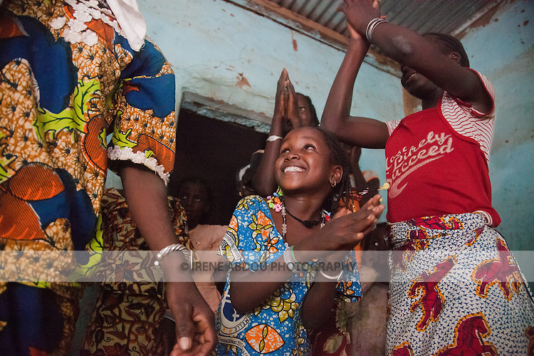 At a Fulani wedding in the town of Djibo in northern Burkina Faso, women and children dance, sing, and clap the night away.