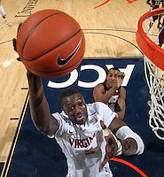 CHARLOTTESVILLE, VA- December 27: Assane Sene #5 of the Virginia Cavaliers shoots the ball during the game against the Maryland-Eastern Shore Hawks on December 27, 2011 at the John Paul Jones Arena in Charlottesville, Va. Virginia defeated Maryland Eastern Shore 69-42.  (Photo by Andrew Shurtleff/Getty Images) *** Local Caption *** Assane Sene