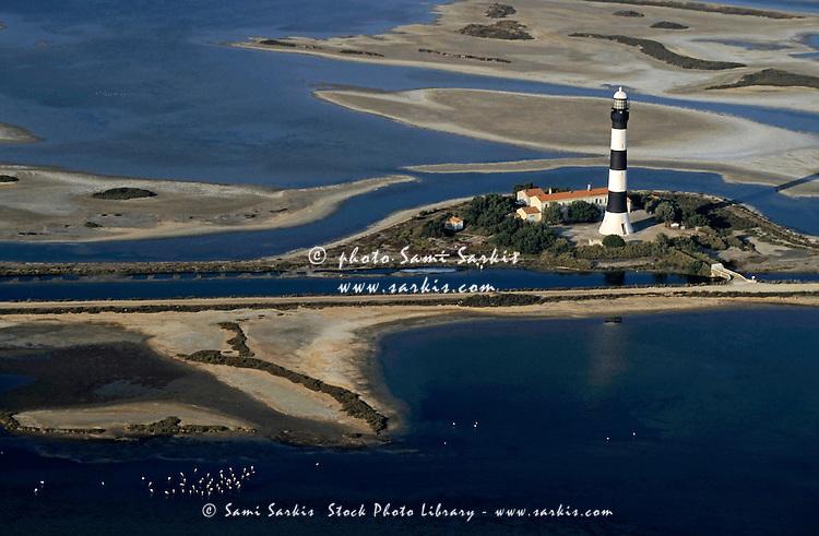 La Gacholle Lighthouse surrounded with blue sea, Camargue, France.