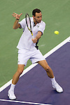 SHANGHAI, CHINA - OCTOBER 12:  Michael Llodra of France returns a ball to David Ferrer of Spain during day two of the 2010 Shanghai Rolex Masters at the Shanghai Qi Zhong Tennis Center on October 12, 2010 in Shanghai, China.  (Photo by Victor Fraile/The Power of Sport Images) *** Local Caption *** Michael Llodra