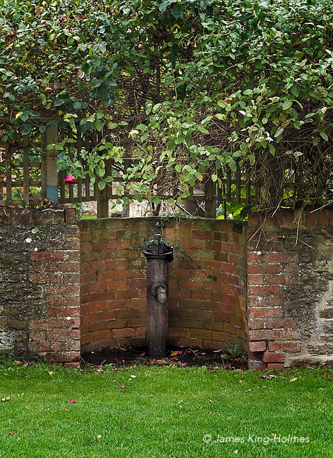 An old cast-iron standpipe in Fyfield, Oxfordshire, UK. The facility, which provided drinking water, was installed for village use in 1903 by St. John's College, Oxford, who were the main landlord of the village, and fed from a nearby well. The alternative to using this standpipe was to pump water manually from one of the village pumps.