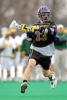 14 April 2007: University of Albany Great Danes' Mike Ammann, a Junior from Putnam Valley, NY, in action against the University of Vermont Catamounts at Moulton Winder Field, in Burlington, Vermont. The Great Danes defeated the Catamounts 14-7...Mandatory Photo Credit: Ed Wolfstein Photo