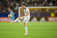 CARSON, CA - SEPTEMBER 15: Dave Romney #4 of the Los Angeles Galaxy crosses a ball during a game between Sporting Kansas City and Los Angeles Galaxy at Dignity Health Sports Park on September 15, 2019 in Carson, California.