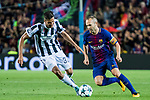 Andres Iniesta Lujan (r) of FC Barcelona is tackled by Rodrigo Bentancur of Juventus during the UEFA Champions League 2017-18 match between FC Barcelona and Juventus at Camp Nou on 12 September 2017 in Barcelona, Spain. Photo by Vicens Gimenez / Power Sport Images