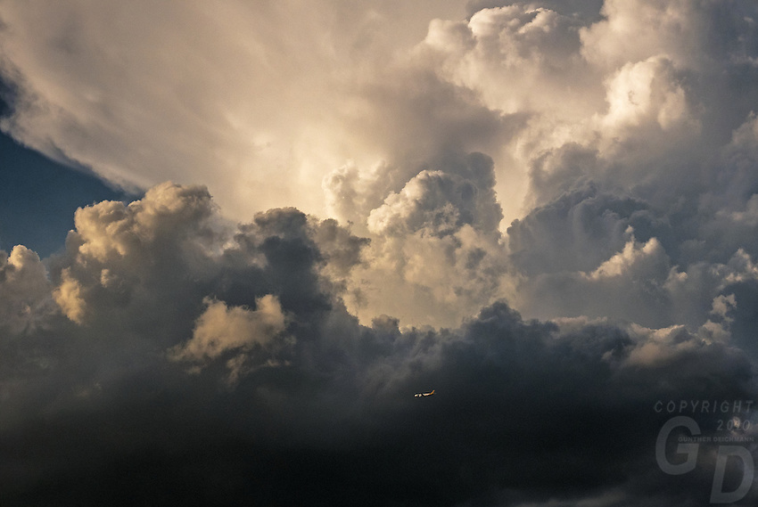 Commercial Airliner flying past a huge storm over Manila Philippine.