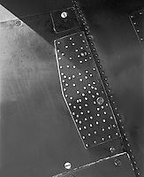 """""""Metal Plate on a B-25 Bomber"""" <br /> 2012 Salute to Veterans Airshow, Columbia, Missouri <br /> <br /> This photograph shows a metal plate attached to a B-25 """"Mitchell"""" bomber. A huge number of rivets and screws secured the plate to the aircraft body. The plane was piloted by Greg Vallero at the 2012 Memorial Day """"Salute to Veterans"""" airshow in Columbia, Missouri."""