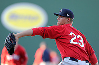 Pitcher Jamie Callahan (23) of the Greenville Drive works on a pitcher fielding drill on the team's Media Day first workout on Tuesday, April 1, 2014, at Fluor Field at the West End in Greenville, South Carolina. Callahan, from Hamer, S.C., was a 2nd Round pick of the Boston Red Sox in the 2012 First-Year Player Draft. (Tom Priddy/Four Seam Images)