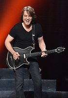 06 October 2020 - Eddie Van Halen, legendary Hall of Fame Guitarist and co-founder of Van Halen -- has died after a long battle with throat cancer at the age of 65. File Photo: 30 March 2012 - Pittsburgh, PA - Guitarist EDDIE VAN HALEN of the legendary rock group VAN HALEN perform on a stop of their US Tour held at the CONSOL Energy Center.  Photo Credit: Devin Simmons/AdMedia