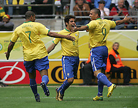 Brazilian forward (9) Ronaldo celebrates his goal with teammates (7) Adriano and (8) Kaka.  Brazil defeated Ghana, 3-0,  in their FIFA World Cup round of 16 match at FIFA World Cup Stadium in Dortmund, Germany, June 27, 2006.