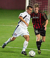 Chris Brown of the Revolution being marked by John Wolyniec of the MetroStars. The New England Revolution were defeated by the NY/NJ MetroStars 2-1 during quarterfinals action of the Lamar Hunt U.S. Open Cup on 8/27/03 at Yurcak Field, Rutgers University, Piscataway, NJ..
