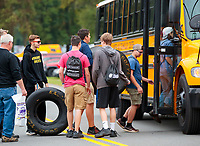 Sep 13, 2019; Mohnton, PA, USA; A student carries a Goodyear racing tire onto a school bus during NHRA qualifying for the Keystone Nationals at Maple Grove Raceway. Mandatory Credit: Mark J. Rebilas-USA TODAY Sports