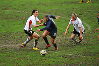 USA's Carli Lloyd tries to escape the grasp of German Birgit Prinz.  The USA captured the 2010 Algarve Cup title by defeating Germany 3-2, at Estadio Algarve on March 3, 2010.