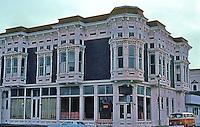 Ferndale CA: Victorian Village Inn (formerly Bank & Office Building), c. 1880's. SE Corner Main St. & Ocean Ave.  Photo '83.